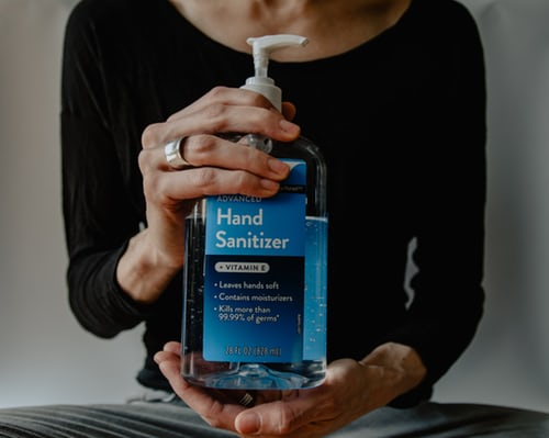 Person holding hand sanitizer